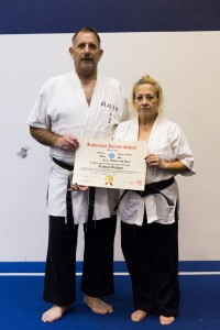 Sensei Tammy Webb receives her yodan in 2014 from Prof. Tony Janovich