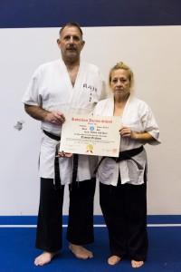 Sensei Tammy Webb receives her yodan in 2014 from Prof. Tony Janovich