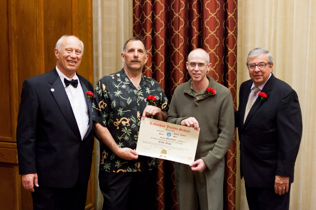 Prof. Clive Guth receiving his 7th Dan in 2012