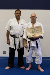 Sensei Dan van Hook being promoted to 2nd Dan