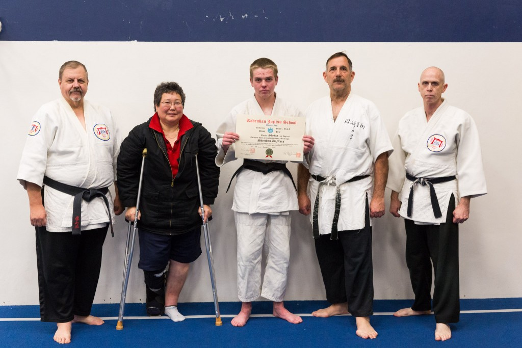 Sheridan receives his shodan. With Profs. Tony Janovich, Janice Okamoto, Clive Guth, and George Arrington