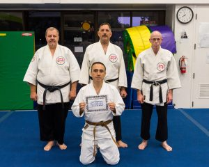 Fyodor (Fred) Delyaei receives his sankyu (3rd degree brown belt) from Profs. Tony Janovich, Clive Guth, and George Arrington