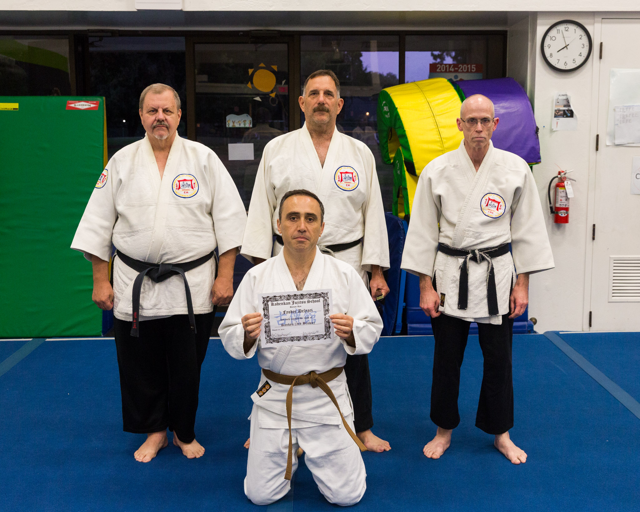 Fyodor Delyaei receives his sankyu (3rd degree brown belt) from Profs. Tony Janovich, Clive Guth, and George Arrington