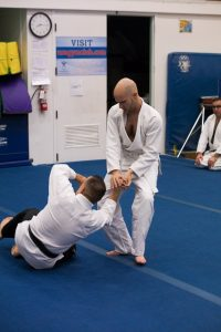 Will performs a wrist twist on Sensei Guillermo Hernandez, Jr.