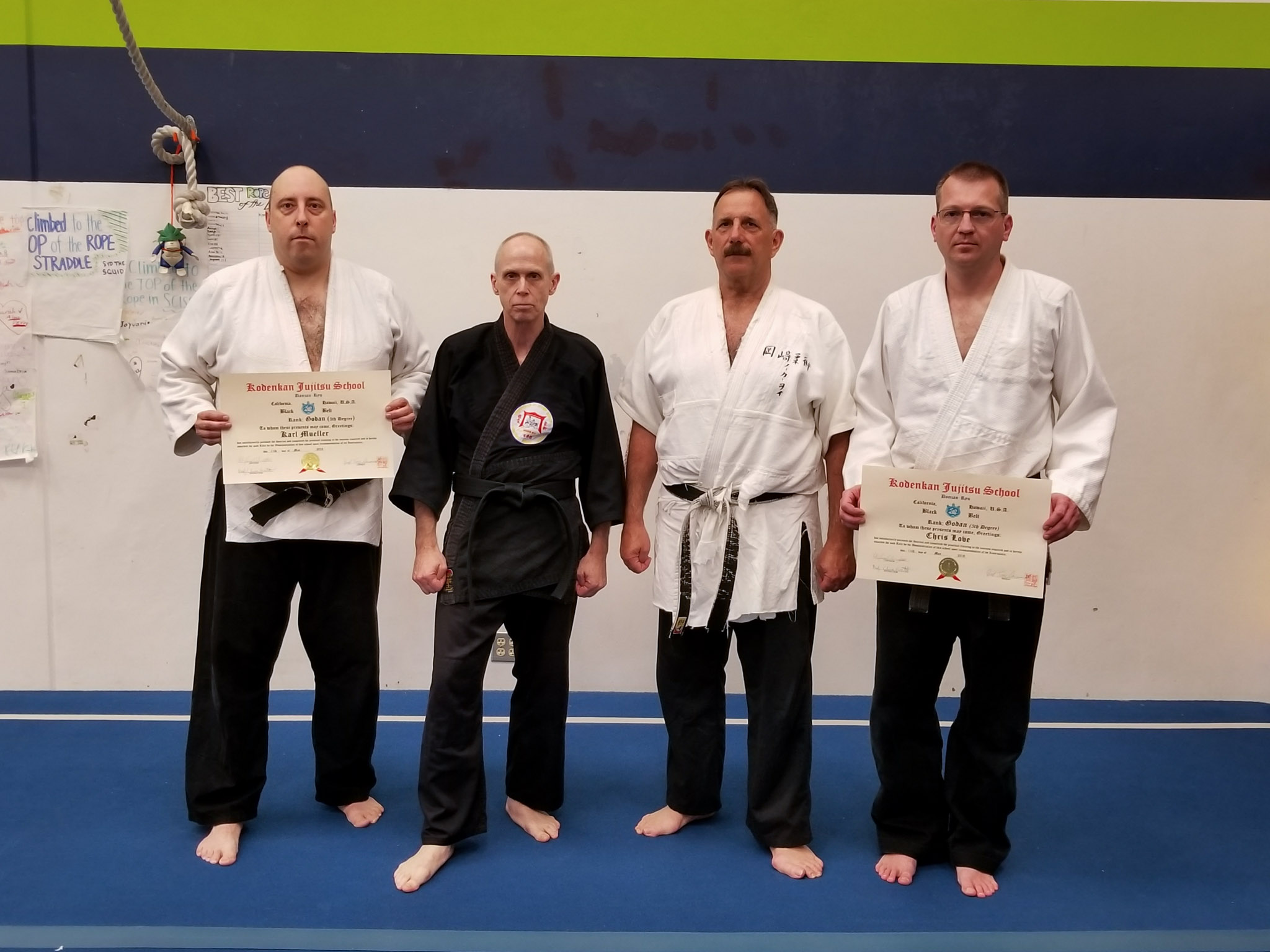 Profs. Tony Janovich and Clive Guth with Senseis Karl Mueller and Chris Love, on their promotions to 5th dan
