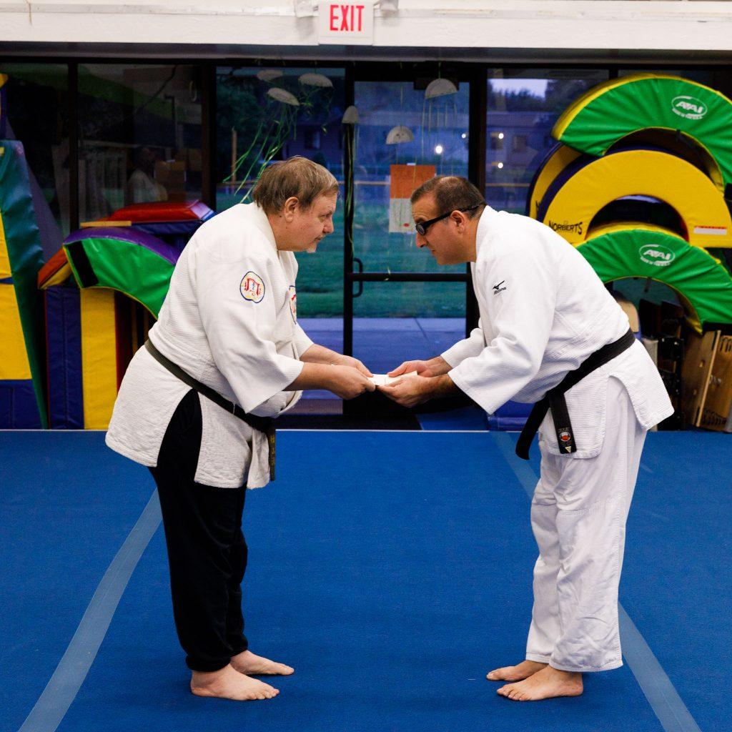 Kevin Sadeghian receives his nidan diploma from Prof. George Arrington