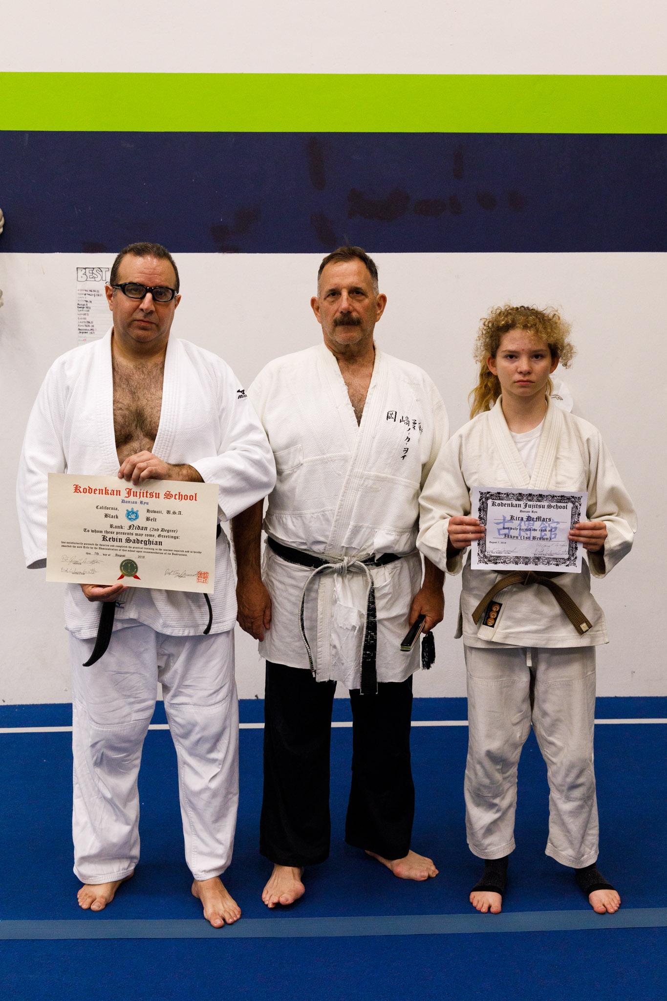 Prof. Tony Janovich with promotees Kevin Sadeghian and Kira