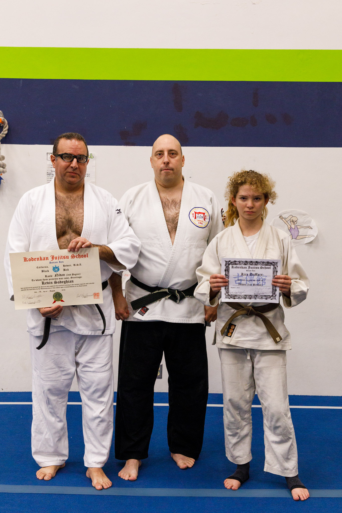 Sensei Karl Mueller with promotees Kevin and Kira